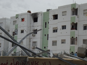 Apartment blocks damaged by fighting