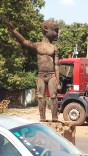 A random wooden statue in the road