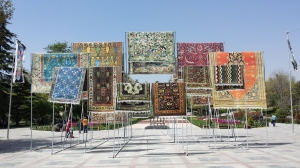 Traditional carpets on display in a park