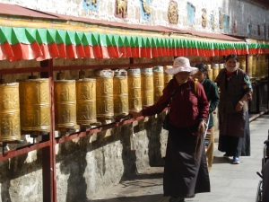 Locals spinning prayer wheels in Lhasa